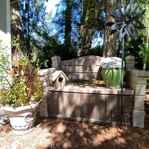 Lot # 96- Plastic Garden Bench with Storage (spiders inside), Ceramic Flower Pot and Thermometer, Resin Pot, Metal Windcatcher.