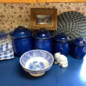 Lot # 114- Vibrant Blue Ceramic Canisters, Villeroy & Boch Pedestal Bowl, Porcelain German Kitty, Framed Picture, Towels.