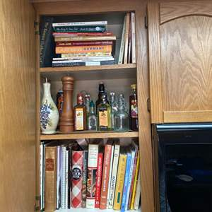 Lot # 121- Contents of Cupboard: Chef Essentials and Cookbooks Galore.