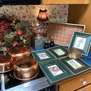 Lot # 122- Copper Cookware (used as wall decor), Framed Pictures, Cranberry Glass S&P Shakers, Wood Tray, Wreath, Metal