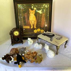 Lot # 124- Framed Cat Picture 26 x 28 from Bombay Co., Padded Foot Stool, Clock, Ceramic Kitty's, Plush Animals.