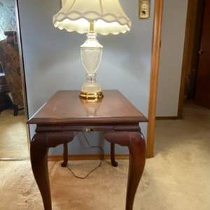 Lot # 155- Side Table with Pull out Drawer (top has a crackle finish), Crystal and Brass Lamp.