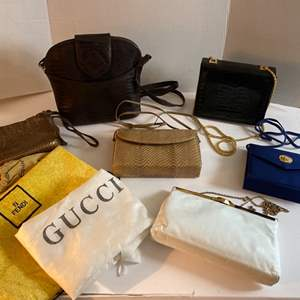 Lot # 169- Picard Leather Cross body (like new), Eel Skin and other Purses. Assortment of Random Dust Bags.