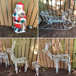 Lot # 192- Two Lighted Reindeers, Lighted Santa Sled and Light up Santa with Rudolph Blow Mold.