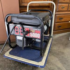 Lot # 201- Coleman Power Mate Pro-Gen 5000 Generator. Includes Power Cord and Handy Push Cart. Owner states no problems, works!
