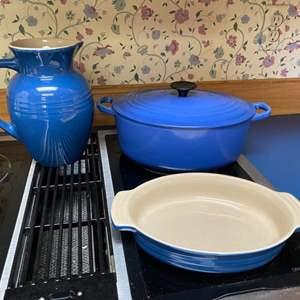 Lot # 224 - Le Creuset Enameled Cast Iron Dutch Oven, Ceramic Casserole, Ceramic Pitcher. Made in France.