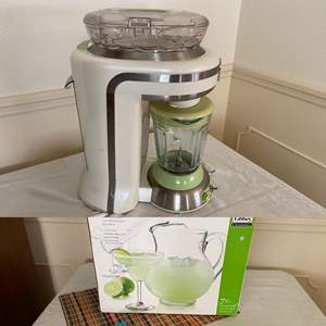 Lot # 226- Margaritaville Bahamas Frozen Concoction Maker, Pack of Coasters, Libby Pitcher with Marg Glasses.