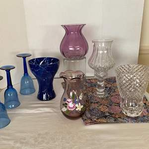 Lot # 235- Three Blue Water Goblets, Crystal and Art Glass Vases, Crystal Candle Lamp, 4 Tapestry Placemats.