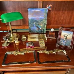 Lot # 272- Brass Eagle Novelties, License Plate Frames, Bolo Tie, Bankers Lamp, Desk Accessories.