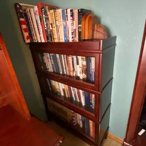 Lot # 280- WWII Encyclopedia, Books, Battle Non-fiction and Fiction, America, Contents of shelves (not the bookcase).