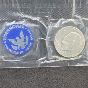 Lot 21 - 1971-S  Eisenhower Uncirculated Silver Dollar Department of the Treasury sealed package
