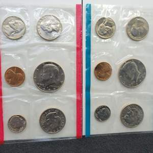 Lot 23 - 1979 P&D Uncirculated Coin US Mint Sets includes two small dollars and two Kennedy Half Dollars that year.