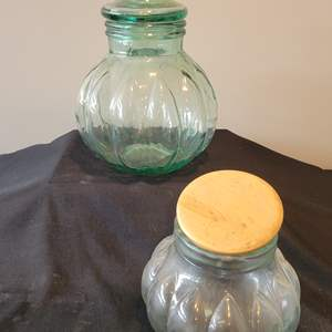 Lot #126 - Green Glass Lidded Jar & Clear Glass Jar w/Wood Lid
