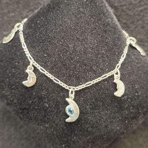 Lot 82 - Vintage Blue Topaz Man in the Moon Sterling Silver Necklace Stamped 925