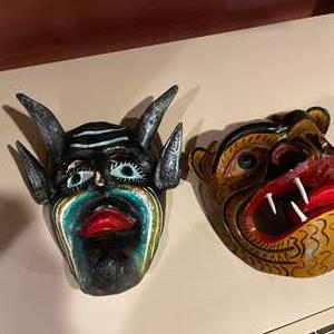 Lot #276 - Hand carved and painted masks