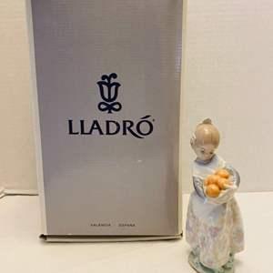 "Lot #187 - Lladro ""Valencian Girl Holding Oranges"" Retired, Designed in 1973. Original Box"