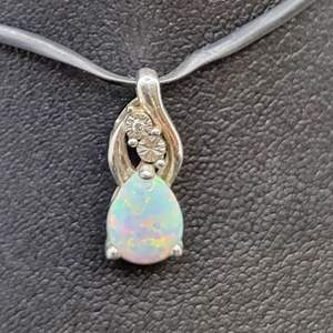 Lot 94 - Sterling Silver and lab created Opal Pendant