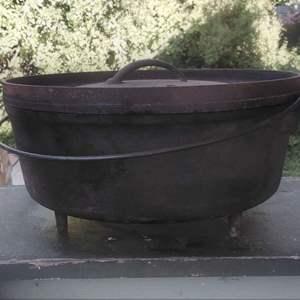 Lot #MW30 - No. 12 Cast Iron Camp Cooking Pot Chuck Wagon Three Legged Bail Handle