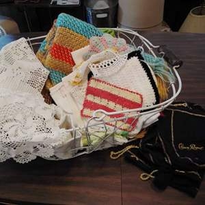 Lot #HW101 - Large Wire Basket Full of Doilies and Linens