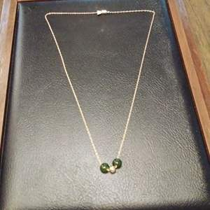 Lot #EL141 - 14K Gold Necklace with 2 Green Beads and 1 Gold Colored