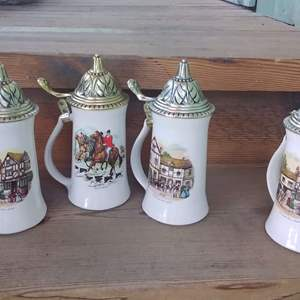 Lot #D245 - 3 McCoy Steins in Great Condition and 1 that is not.