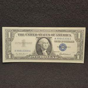 Lot 59 - 1957 AU One Dollar Silver Certificate United States Currency Note, Blue Seal