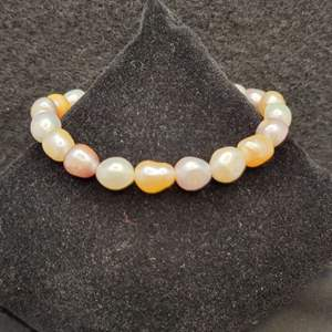 Lot 80 - Bracelet of Genuine Pearls, Assorted Colors including pink, peach, cream