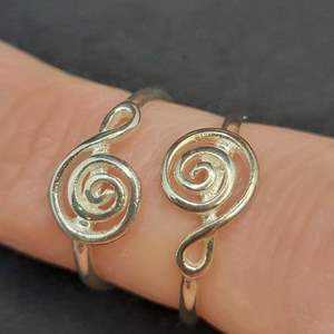 Lot 86 - Two Sterling Silver Rings, size 6 and 7, Treble Clef Design, vintage but new, never sold.