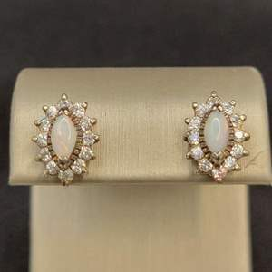 Lot 90 - Vintage Silver Earrings overlaid with gold set with opal, stamped SS.