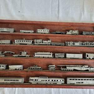 Lot #40 - Vintage Franklin Mint Pewter Train Cars in Wood Case. Measures 21x12