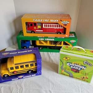 Lot #53 - Fun Chevron Cars Fire Truck, Car Carrier, School Bus and Fun Club Kit, All New in Box