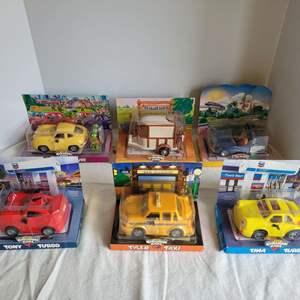 Lot #54 - NIB Chevron Cars: Case Coupe, Horace 'N Trailer, Autopia, Tony Turbo and More