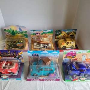 Lot #55 - Chevron Cars; Autopia, C.C. Boat & Trailer, Sam Sedan, Rudy Ragtop and More. New in Package