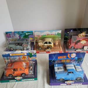 Lot #57 - Fun Chevron Cars Collection, New in Package: Ltd. Ed. Leo Limo, Maddie Mudster, Payton Pizza and More
