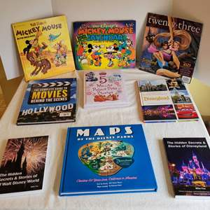 Lot #84 - Disney Books: Maps of the Parks, Vintage Mickey Mouse Golden Book and Calendar and More