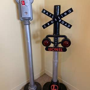 Lot #110 - Limited Edition 4 Ft. Lionel Train Signal Crossing Bank and Plastic Parking Meter Coin Bank