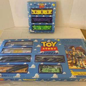 """Lot #147 - """"Toy Story""""  HO Scale Tri Pack and Limited Edition 1996 Express Train Set"""
