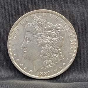 Lot 2 - 1889 AU Morgan Silver Dollar