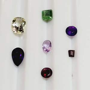 Lot 76 - 4.0ctw Genuine Gemstones assorted faceted cuts including Emerald, Amethyst, Garnet and More
