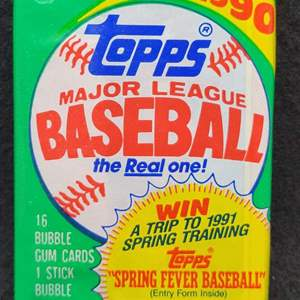 Lot 104 - TOPPS 1990 unopened pack of Baseball Cards.   See link to some of the cards in the TOPPS 1990 issue...