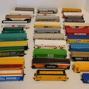 Lot #23 -  HO Scale Railroad Cars and Trailers, Wonder Bread, Maxwell House, Santa Fe, and More for a Total of 30