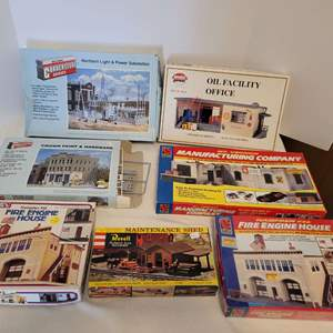 Lot #39 -  Group of Seven Train Model Kits including Hampden #46 Fire Engine House, Revell Maintenance Shed and More