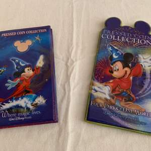 Lot #73 -  Walt Disney World Pressed Coin Collection Book with Coins from Epcot and Disneyworld
