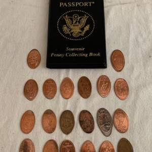 Lot #74 -  Penny Passport Including Pressed Pennies From Disneyland, Epcot and The Kennedy Space Center