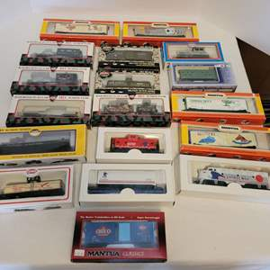 Lot #99 -  Model Power and Mantua HO Scale Model Trains, Railroad Flat Cars, Military Action Series, and Old Time Bunk Car