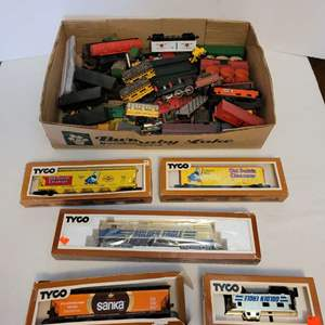 Lot #101 -  Tyco Brand New in Box HO Scale Caboose, Box Car, Hopper Car, and Open Box of Misc. Pieces Such as Bachmann Train