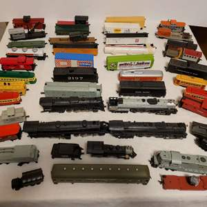 Lot #108 -  Bachmann & Rivarossi Model Trains, Flat Beds, Box Cars, Western Maryland, Union Pacific, & Misc. Pieces