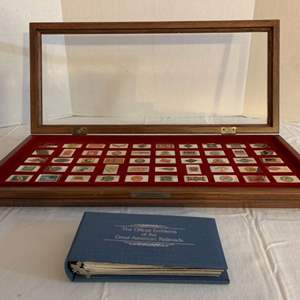 Lot #118 -   Display Case Full of Sterling Emblems, 23.2 Grams Each. Official Emblems of the Great American Railroads
