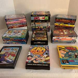 Lot #138 -  Group of DVD's Including Hanna Barbera Wacky Races, Happy Halloween Scooby Doo, Looney Tunes, Spider Man & More