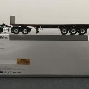 Lot # 161 - WSI Die Cast # 02-1182 Volvo FH3 Axle 6x2 Three Axle Flatbed Tractor * Dice Carriers * 1:50